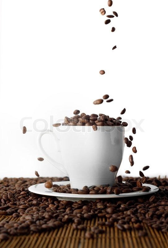 Coffee seeds on wooden table, stock photo