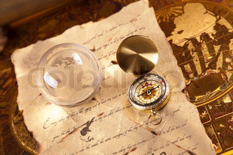 Vintage Golden Compass, navigation equipment, stock photo