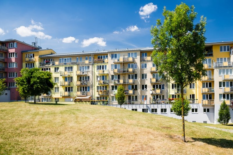 Eco friendly newly built block of flats in green nature, stock photo