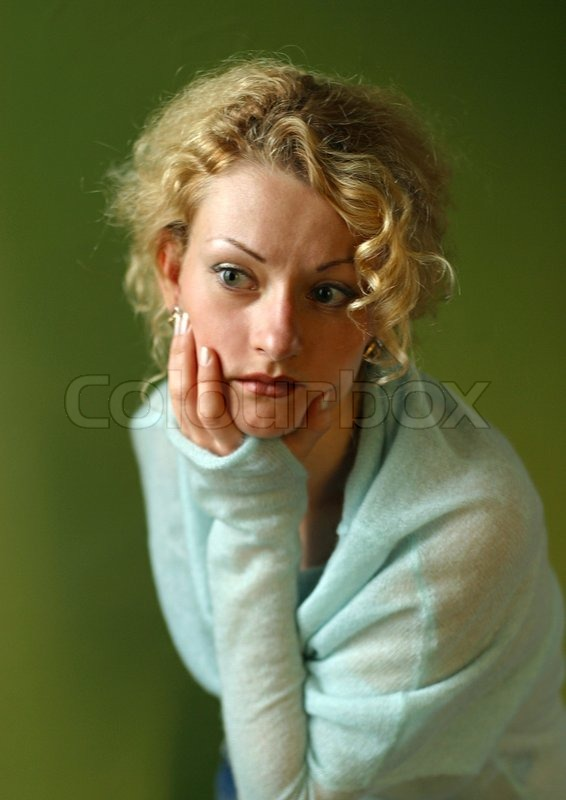 Stock image of 'Portrait of attractive thoughtful lady, chin on her hand\'