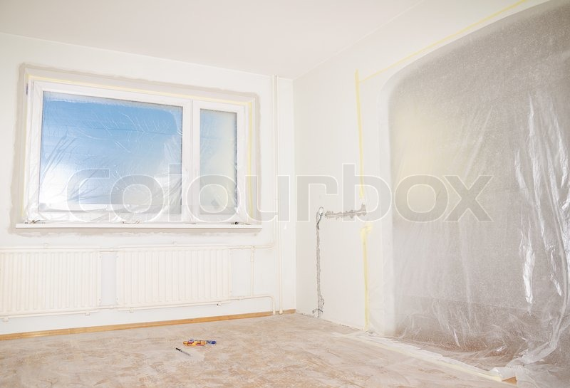 Room renovation. White room repair with dirty floor, stock photo
