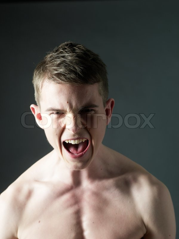 young boy screaming angry stock photo colourbox