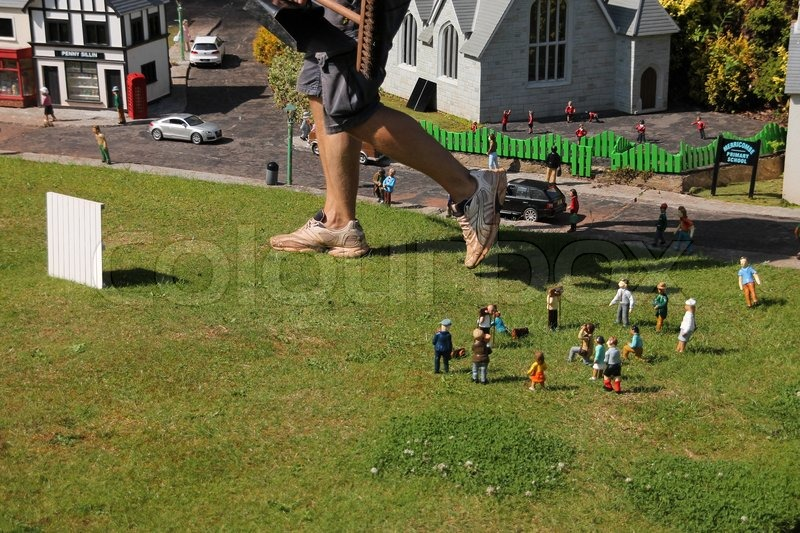 Oh....ooohhh, great steps from the \'giant\', the gardener, the mini dolls are scared in mini world in summertime, stock photo