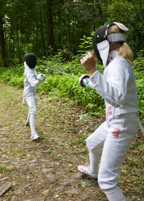 Two girls practice fencing in the woods | Stock Photo ...