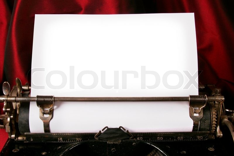 Old type writer with a blank sheet of paper, stock photo
