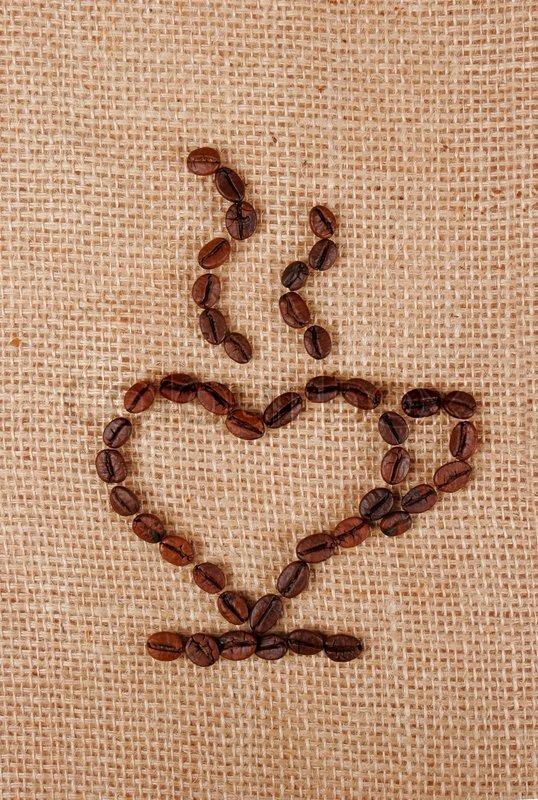 Single Love Coffee Cups hearts on a burlap fabric, stock photo