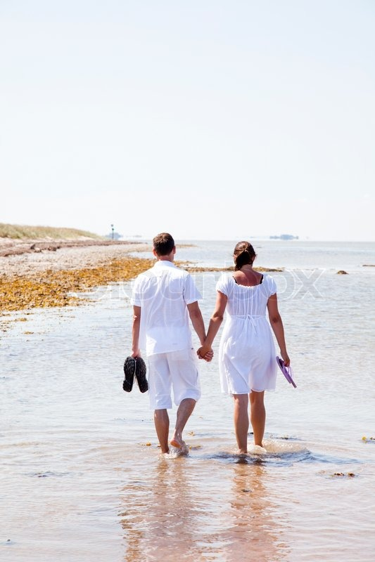 Husband And Wife Walking On The Beach  Stock Photo -2298