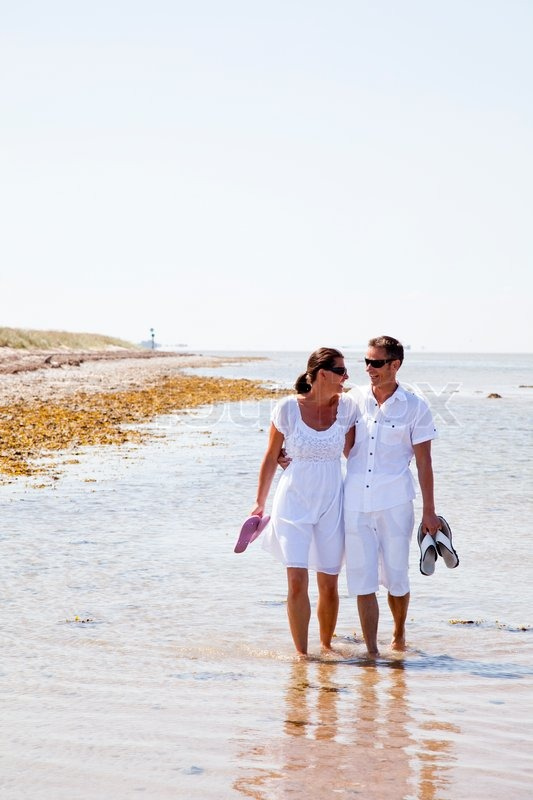 Husband And Wife Walking On The Beach  Stock Photo -5646