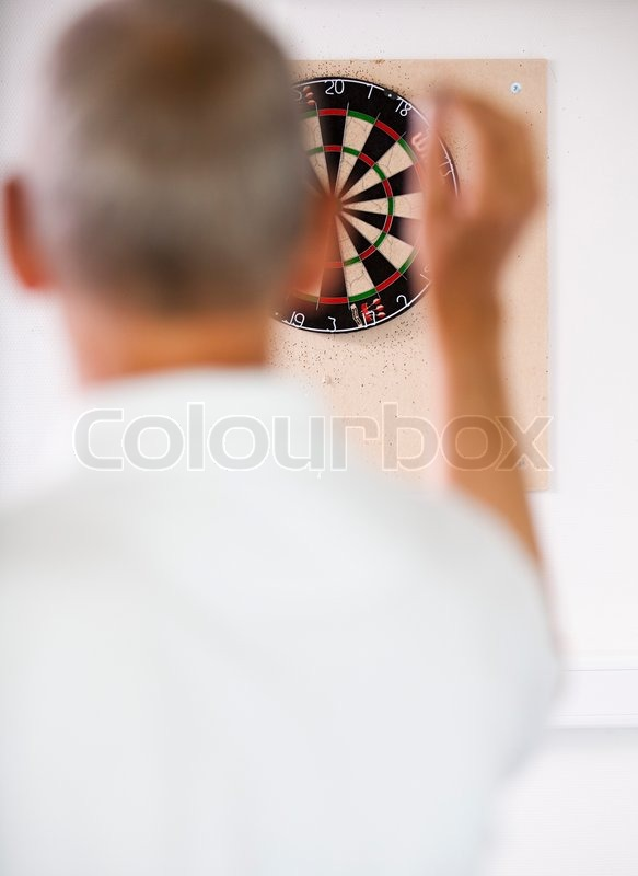 Business people playing dart in a break room at the office. Business people having fun i the break/ recreation room, stock photo