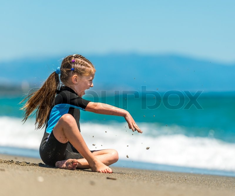 photo of girls sitting in water at beach № 16873