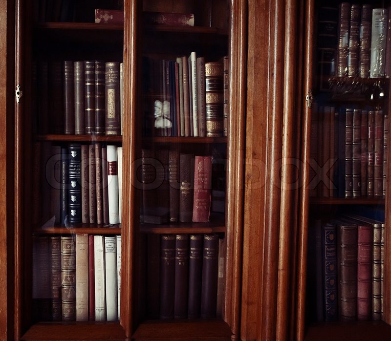 Historic books in a old library, stock photo