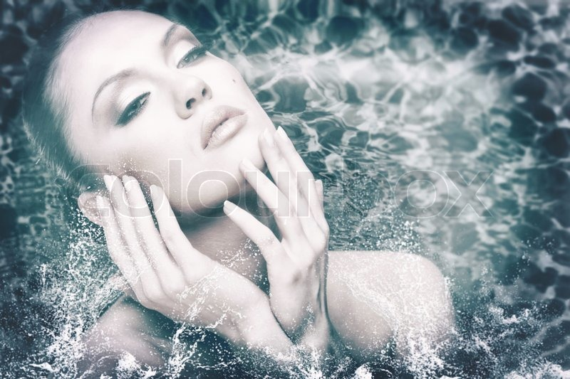 Beauty female portrait with water drops and foam, stock photo