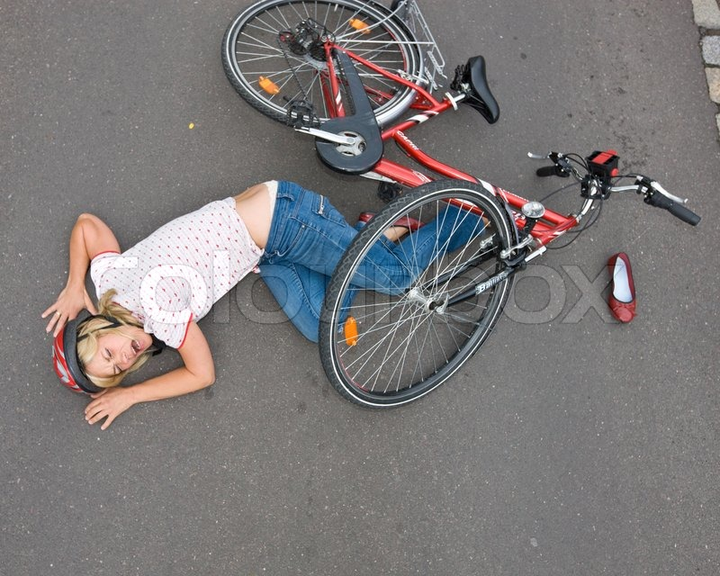 Top View Of A Female Cyclist Who Falls From Her Bike