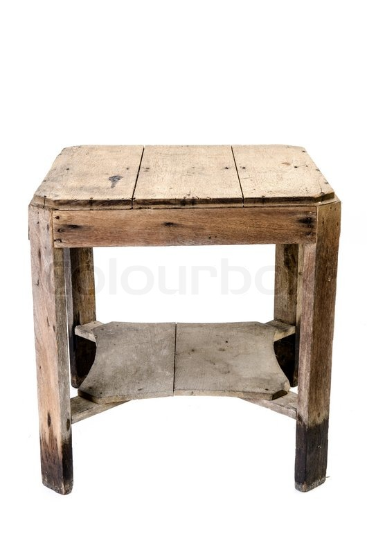 dirty old wooden table isolated on white background stock photo
