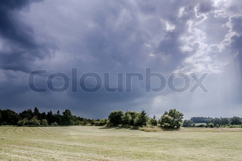 Landscape with dark thunder clouds, stock photo