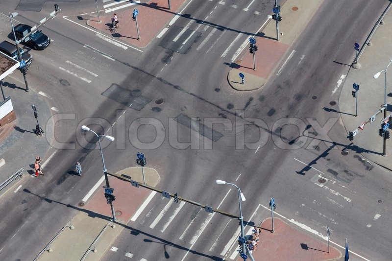 High angle view of an empty street intersection with cross walk markings, traffic signal lights, stock photo
