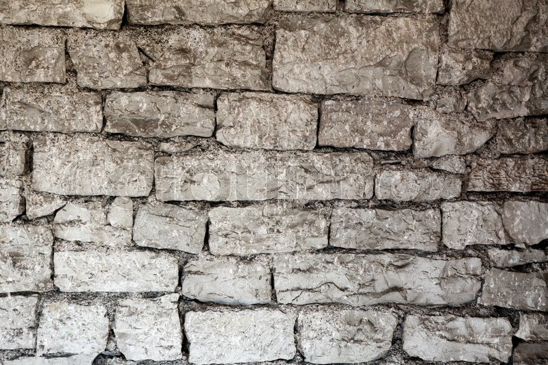 Fragment of ancient masonry walls of ashlar, stock photo