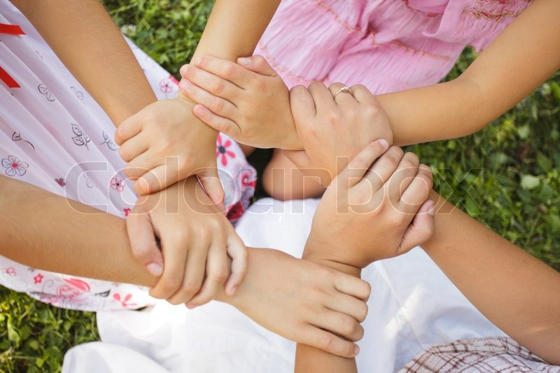 Friends forever - three girls hold hands together, close up arms | Stock Photo | Colourbox