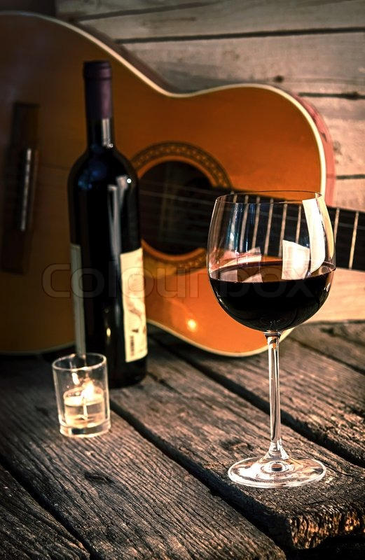 Guitar And Wine On A Wooden Table Romantic Dinner