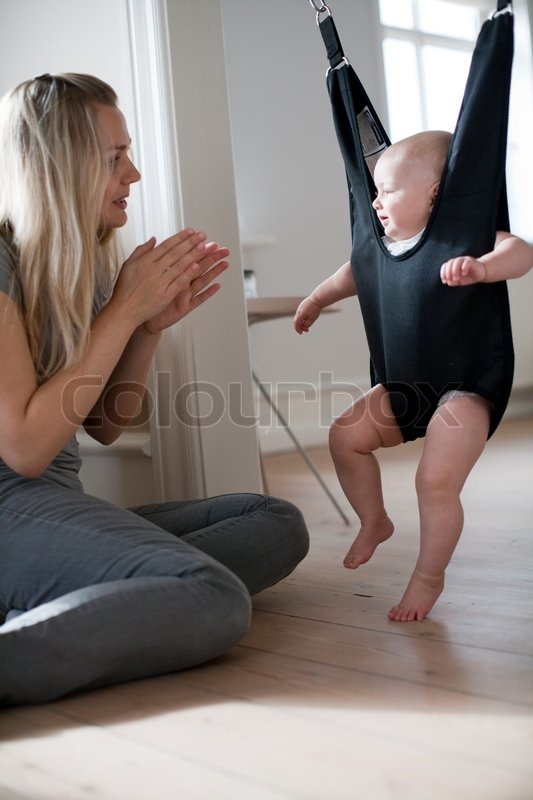 3ebbc2981 A baby boy hanging on a doorway jumper