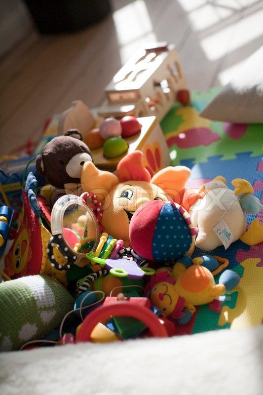 Baby Floor Toys : Assorted baby toys on the floor stock photo colourbox