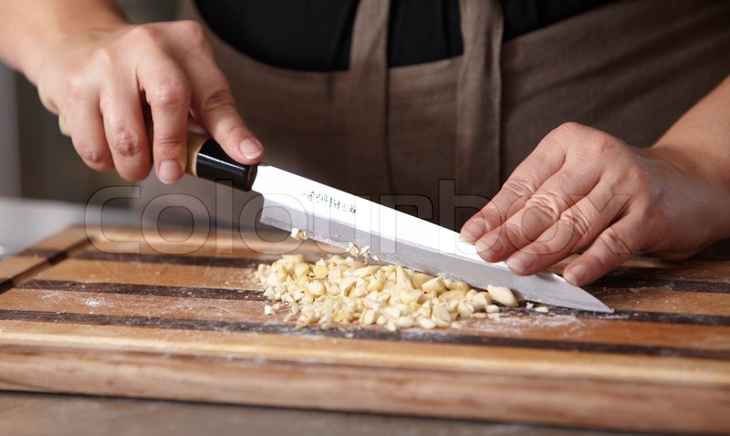 A Woman Chopping Nuts Stock Photo Colourbox