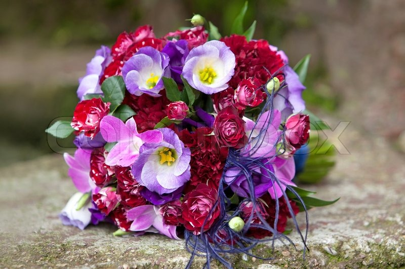 Wedding bouquet. Bouquet of fresh flowers for the wedding ceremony. Bouquet of colorful flowers on natural background. Bridal bouquet, stock photo