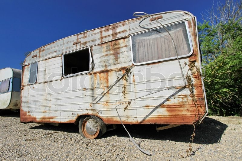 Old Decayed And Abandoned Caravan In Nature