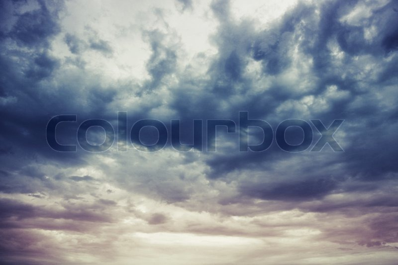Dark blue stormy cloudy sky natural photo background, stock photo