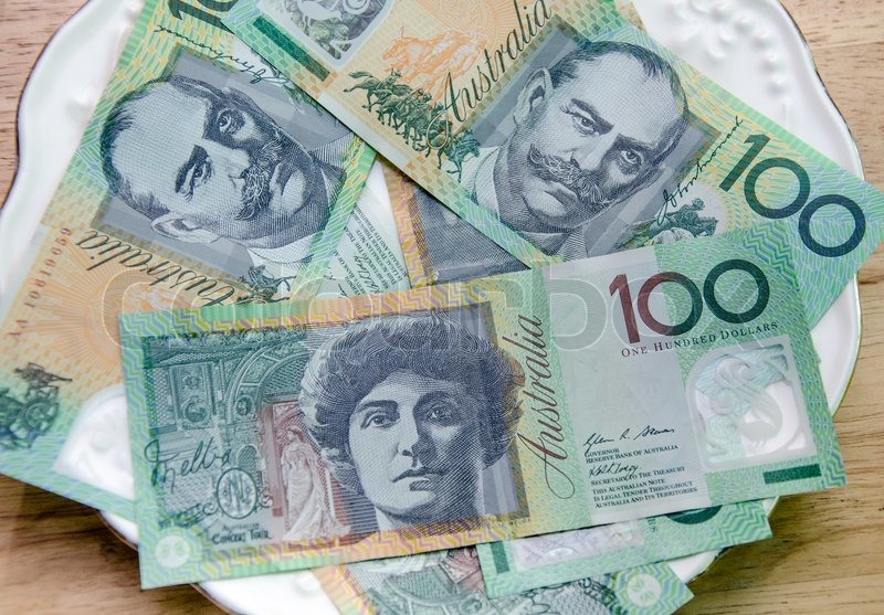 Colorful of Australian Currency on white plate on wood table, stock photo