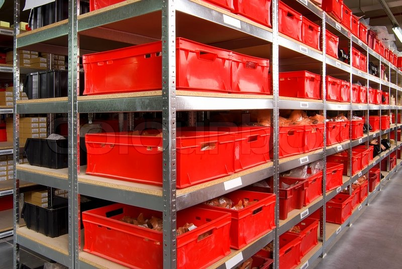 Storage room with red plastic drawers and shelves, stock photo