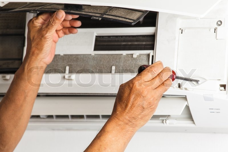 Man repair air conditioner , stock photo