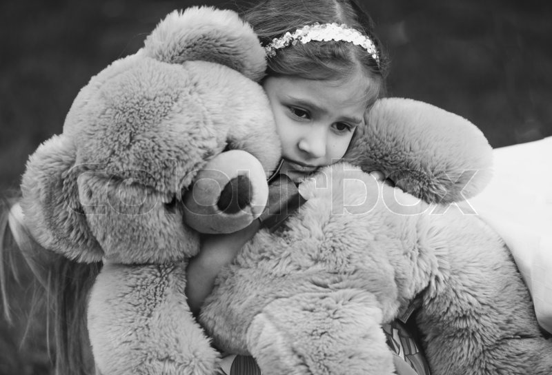 Black and white portrait of small crying girl hugging ...Little Girl With Teddy Bear Black And White