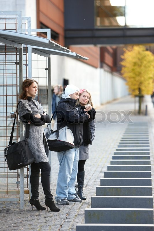 College Students Waiting For The Bus Stock Photo Colourbox