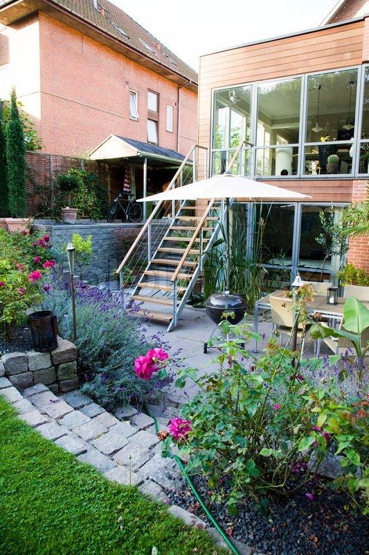 Garden patio with garden furniture, stock photo