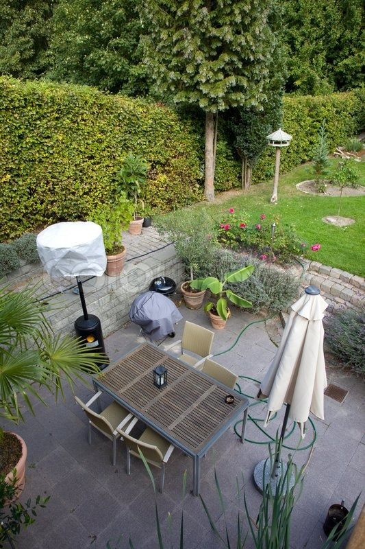 Patio with garden furniture, stock photo