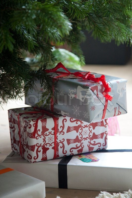 Stock image of 'Christmas presents under the Christmas tree'