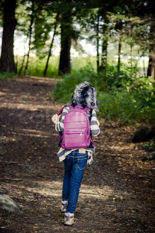 Young Girl With Purple Backpack And A Stock Photo