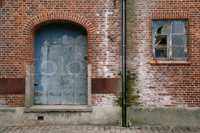 Old dilapidated warehouse with blue door and broken window. | Stock Photo | Colourbox & Old dilapidated warehouse with blue door and broken window. | Stock ...