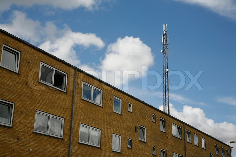 Mobile Mast On Top Of Apartment Building