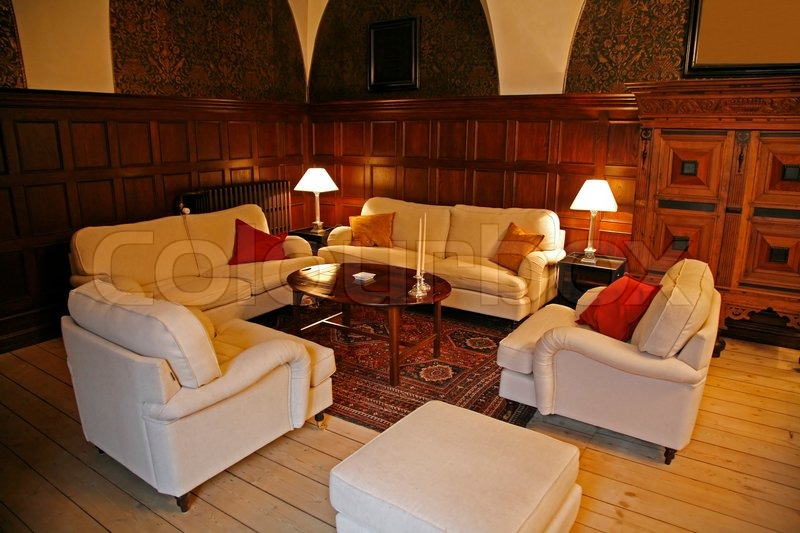 Living room in the 500 years old Castle Holckenhavn, Denmark. Today driven as a wedding hotel. 1600 ISO with natural lightening from the windows, stock photo