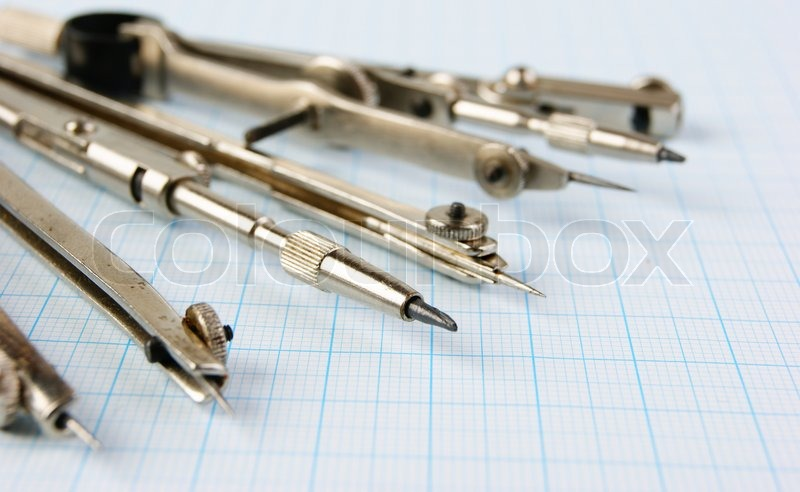Old drawing tools on graph paper, stock photo