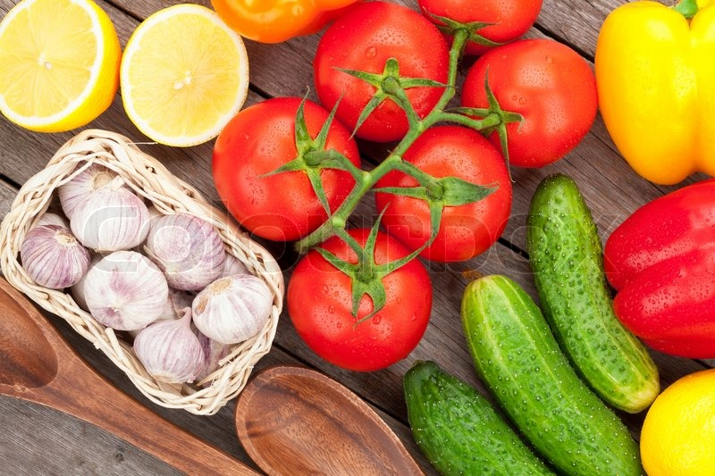 Stock image of 'Fresh ripe vegetables on wooden table'