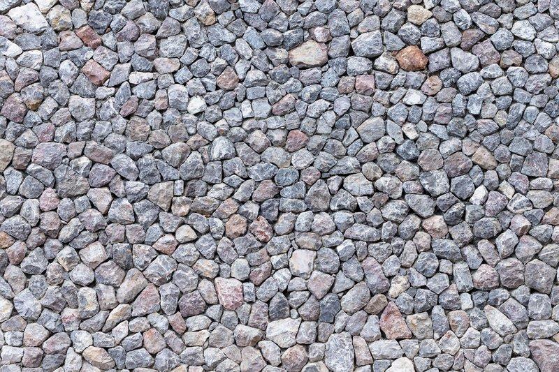 Modern stone brick wall made of irregular shape rock, stock photo