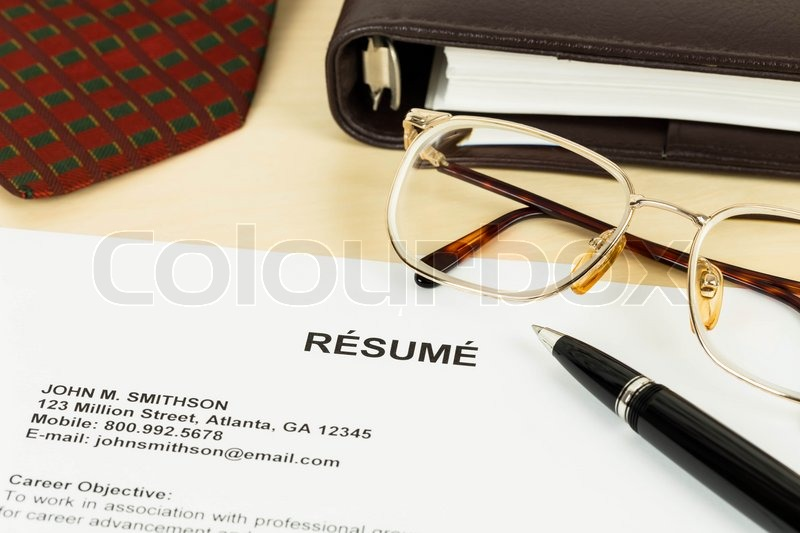 Resume, pen, neck tie, glasses, and notebook, stock photo