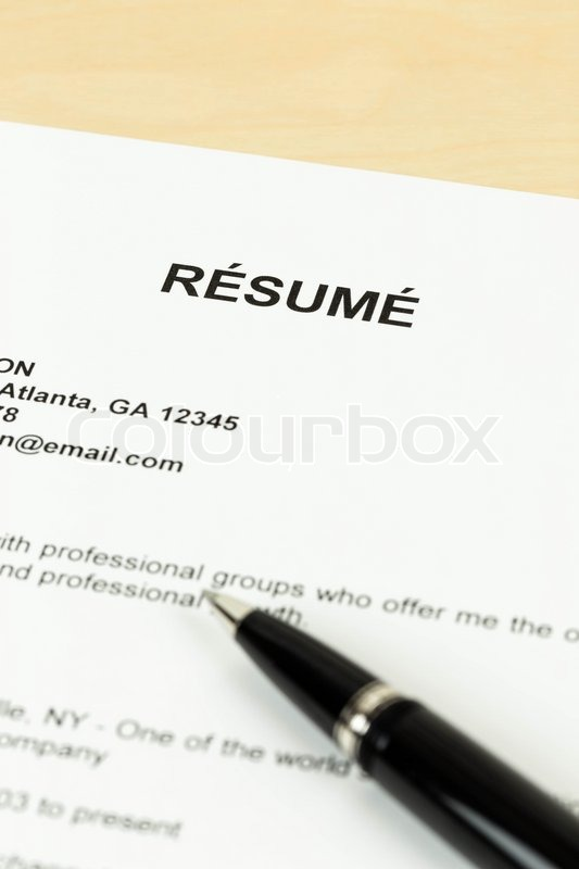 resume with pen on table closeup