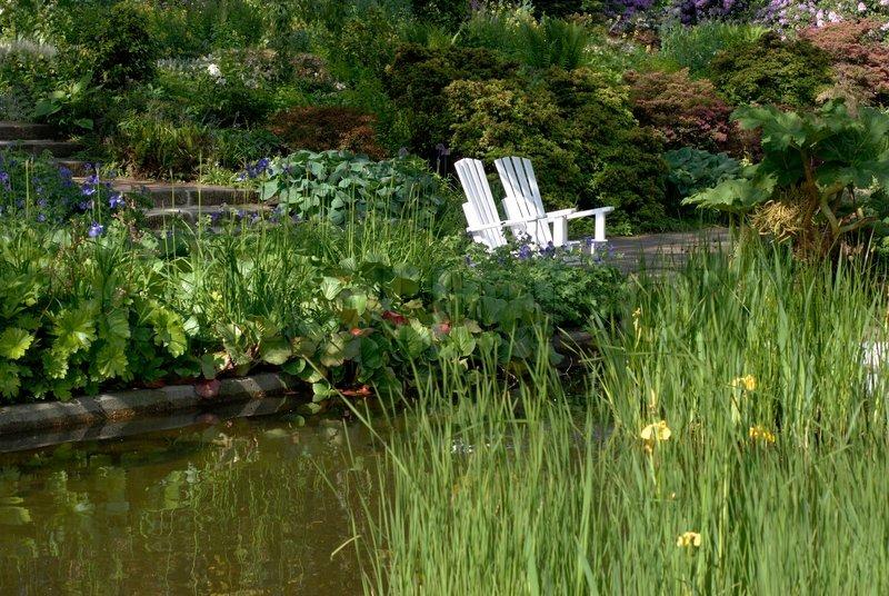 Bilder Blumengarten blumengarten park mit terrasse stühle pflanzen und blumen park in