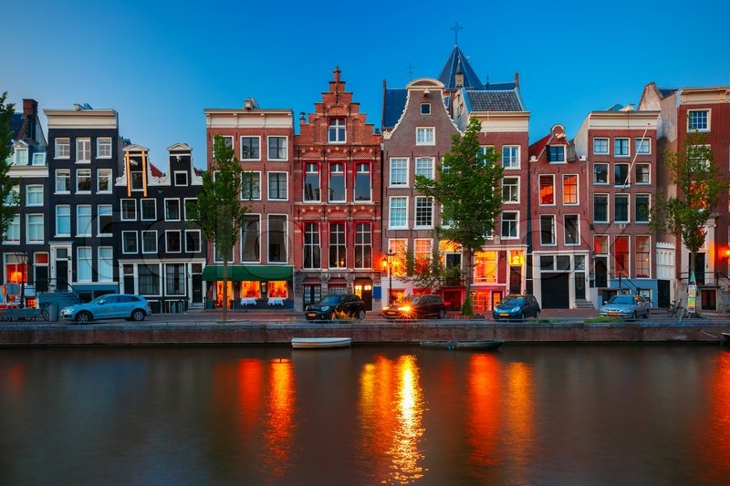 Night city view of Amsterdam canal, typical dutch houses ...