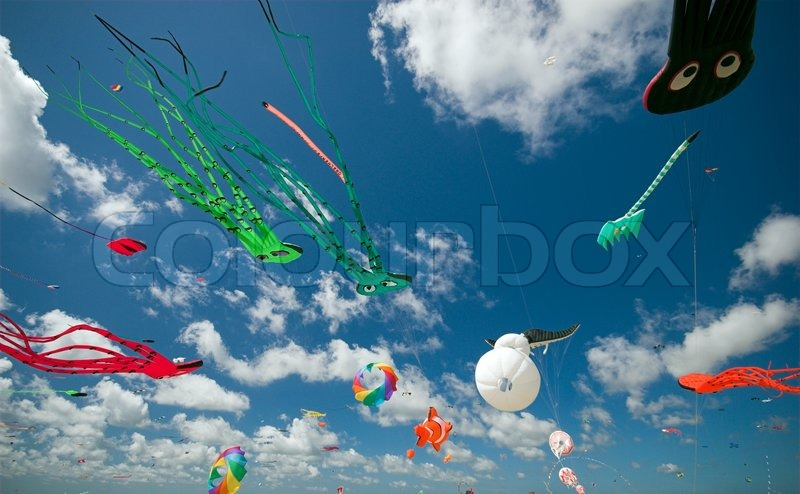 Stock image of 'Fun in the Air. Fantasy Kites High-Up in the Blue Sky a Sunny Day on the Beach. Kite Flying Festival on Fanoe, Denmark.'