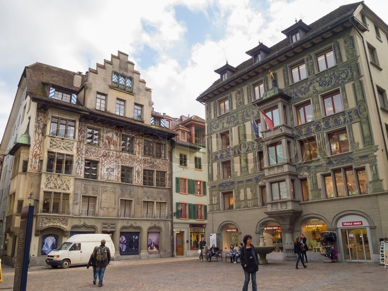 LUCERNE, SWITZERLAND - OCTOBER 26, 2011: Old Fresco painted on Historical buildings at picturesque square Muhlenplatz on October 26, 2011 in Lucerne, Switzerland, stock photo
